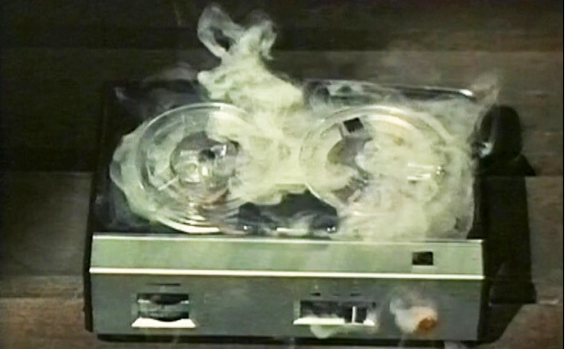 old fashioned tape recorder with smoke coming out of it